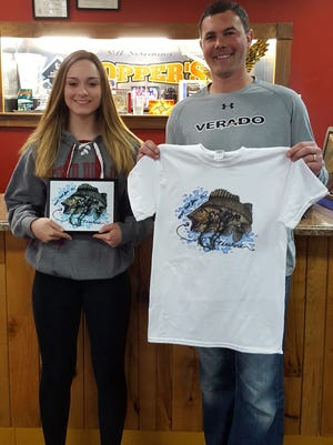 Sydney Scola, the T-shirt contest winner of the fifth grade through ninth grade category, displays her design with Dave Hopper of Hopper's Silk Screening and All Star Trophy.