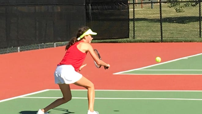 Shawnee Heights freshman Melanie Lysaught returns a shot during Tuesday's United Kansas Conference girls tennis tournament. Lysaught won the league singles title. [Rick Peterson/The Capital-Journal[