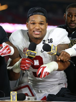 Alabama DL Da'Shawn Hand celebrates after defeating Clemson in the 2016 CFP national championship game. The Detroit Lions drafted him in the fourth round of the 2018 NFL draft.