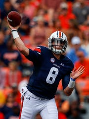 Auburn quarterback Jarrett Stidham (8) throws a pass during the first half of an NCAA college football game against Mercer, Saturday, Sept. 16, 2017, in Auburn, Ala.