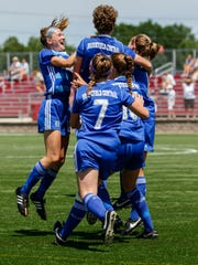 Brookfield Central teammates swarm junior Jenny Cape (top center) after she hooked a corner kick into the goal during the WIAA division 1 girls state soccer semifinal against Oconomowoc at Uihlein Soccer Park in Milwaukee on Thursday, June 15, 2017.
