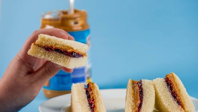 The simplicity of enjoying a peanut butter sandwich can be quite comforting.