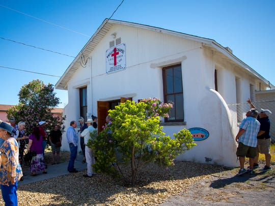 A crowd gathers outside the Phillips Chapel Christian Methodist Episcopal Church in the Mesquite Historic District of Las Cruces before the start of services, July 9, 2016. People came to the the chapel, which was originally built in 1911, to celebrate its restoration after years of deterioration and to unveil a bronze plaque commemorating the chapel's listing on the National Register of Historic Places.