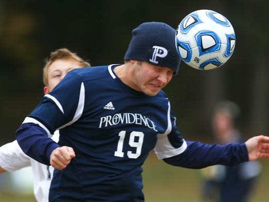 Providence's Jason Murner heads the ball during the match against Oldenburg Academy in the Boys' Class A Semi-State at Floyd Central High School Saturday morning. Providence won 2-0.