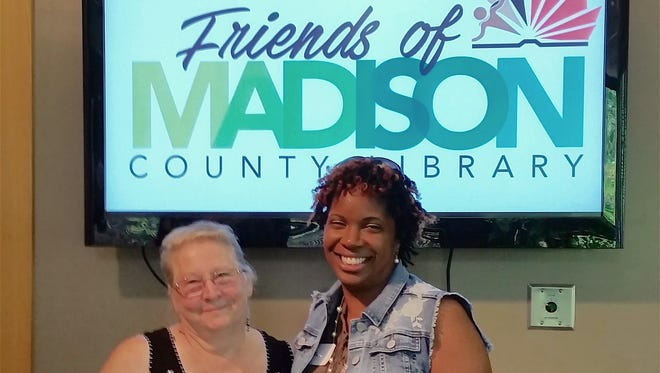 Dana Millen, right, of Orangeburg, South Carolina, submitted the winning design in the Friends of the Madison County Library Logo Competition. She's pictured beside FMCL president Susan Christian.