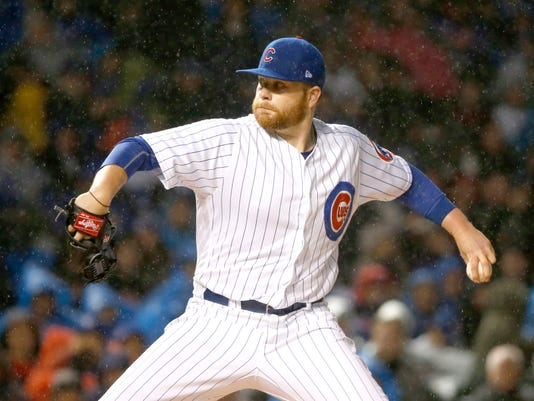 Chicago Cubs starting pitcher Brett Anderson delivers during the first inning of a baseball game against the Philadelphia Phillies, Monday, May 1, 2017, in Chicago. (AP Photo/Charles Rex Arbogast)