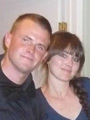 Marine Staff Sgt. Robert Cox, who died in a military plane crash in July, is pictured with his sister, Amber Cox.