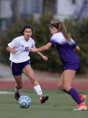 Shasta's Isabella Yonge takes the ball past a Bradshaw Christian player in a 2018 postseason match.