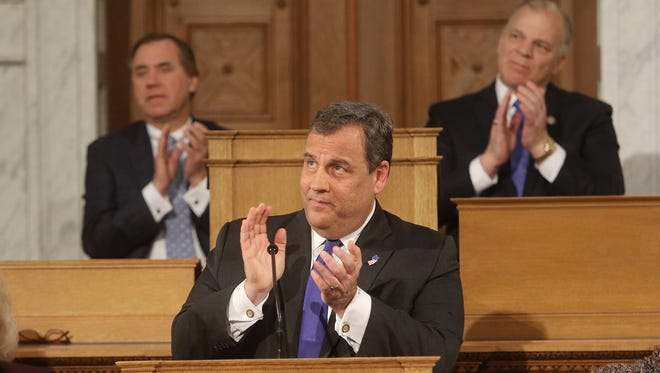 Assembly Speaker Craig Coughlin, left, and Senate President Stephen Sweeney, right, applaud as Gov. Chris Christie delivers his final State of the State address on Jan. 9, 2018.