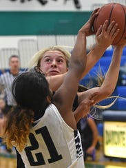 Damonte's Alexus Hunter blocks a shot by McQueen's