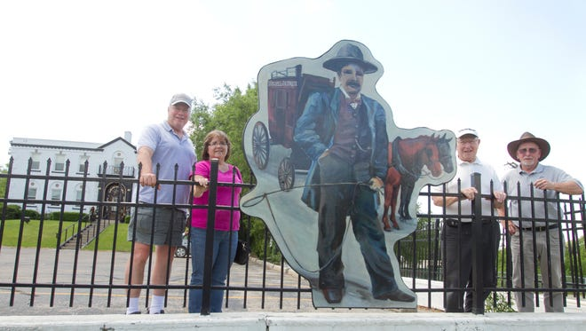 "As part of the Brighton Area Historical Society's initiative called ""Brighton's Victorian Silhouettes,"" depictions from 13 artists representing landmark developments in Brighton's history are being installed around the city. Posing near one of the first installed, in front of the Greater Brighton Area Chamber of Commerce building, Thursday, June 8, 2017, are , from left, historical society President James Vichich, artist Diane Schenkel, Bob Knight and Joe Collins. The man depicted in the silhouette is Johnny Blessed, circa the 1850s, painted by Brighton Art Guild member Leah Kucharek."