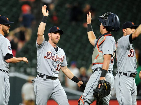 Tigers third baseman Andrew Romine (17) high-fives teammates after the Tigers' 7-5 win over the Orioles on Thursday, August 3, 2017, in Baltimore.