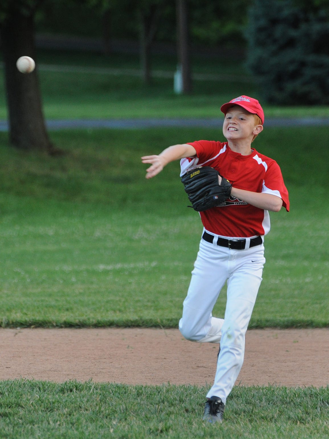 Holden Neukirchner throws the ball to first during
