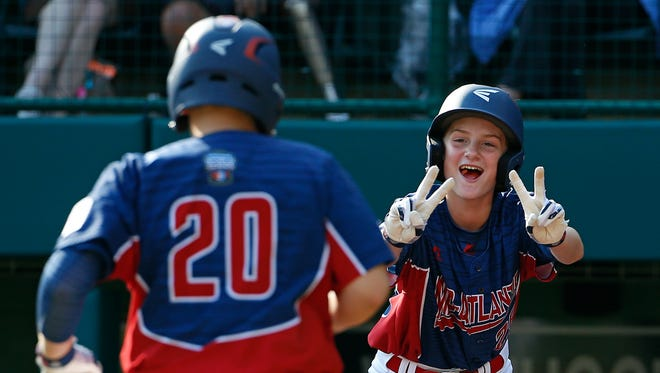 Jackson, N.J.,'s R.J. Vashey (20) is greeted at home plate by Anthony Abbonizio after hitting a two-run home run in United States pool play at the Little League World Series tournament in South Williamsport, Pa., Monday, Aug. 21, 2017.