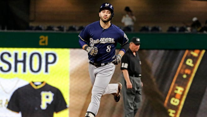Ryan Braun circles the bases after hitting a long home run to left-center field, giving the Brewers a 1-0 lead over the Pirates in the fourth inning on Monday night in Pittsburgh.