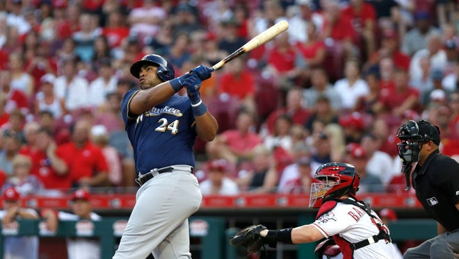 Brewers slugger Jesus Aguilar belts a two-run homer against the Cincinnati Reds during the third inning Thursday night.