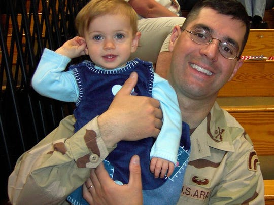 The last photo taken of Capt. Phillip Esposito before he left for Iraq in January 2005. With him is his daughter, Madeline Rose, who was 18 months old.