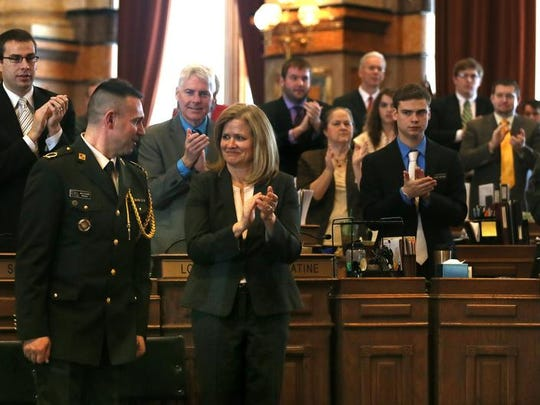 Kosovo Brig. Gen. Xhavit Gashi receives a warm welcome at the Statehouse on Wednesday. To his right is Suzanne Orr, wife of Maj. Gen. Timothy Orr of the Iowa Guard.