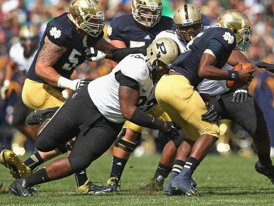 Everett Golson #5 of the Notre Dame Fighting Irish is sacked by Kawann Short #93 of the Purdue Boilermakers at Notre Dame Stadium on September 8, 2012 in South Bend, Indiana.