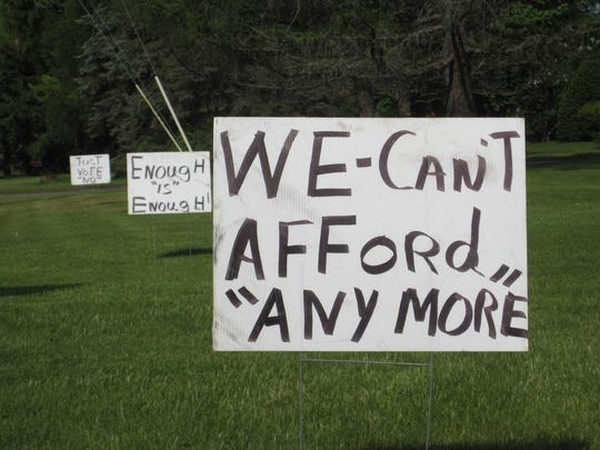 """Signs along Blakely Road in Colchester urge a """"no"""" vote on a proposed school budget in2010"""