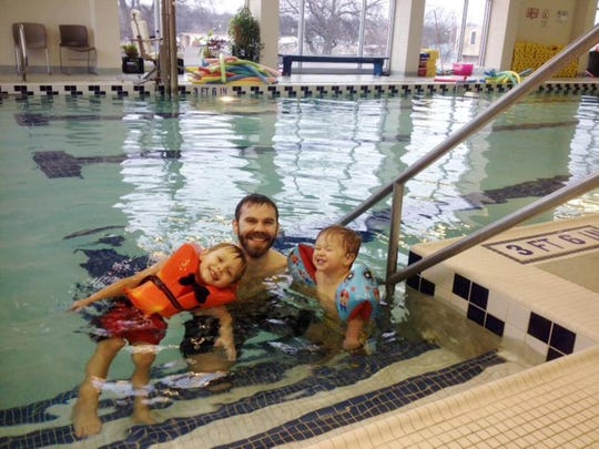 Brian Baer and sons Luke and Charlie enjoy some indoor swimming fun at Coleman Park Community Center.