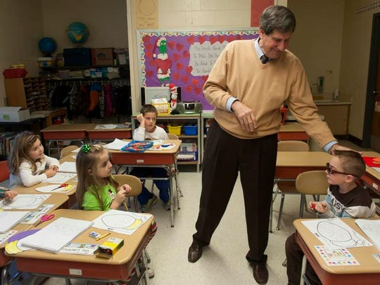 Vincent Cardile, principal of Whitman Elementary School in Turnersville, visits the first-grade class of teacher Julia Fones on Wednesday, December 18, 2013. Cardile is retiring after 24 years as principal at the school.