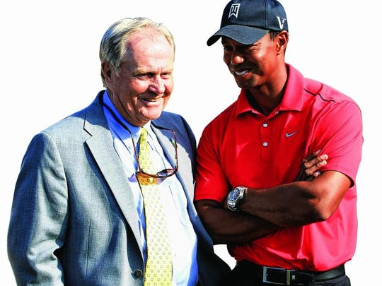 """FILE - In this June 2, 2012, file photo, Jack Nicklaus, left, talks with Tiger Woods after Woods won the Memorial golf tournament at the Muirfield Village Golf Club in Dublin, Ohio. Four years ago, with a major championship lineup of courses that favored Woods, Nicklaus said it would be a """"big year"""" for Woods if he was going to break Nicklaus' record. The same might be true for 2014, but Woods' age (38) might be as important as where the majors are played. (AP Photo/Tony Dejak, File)"""