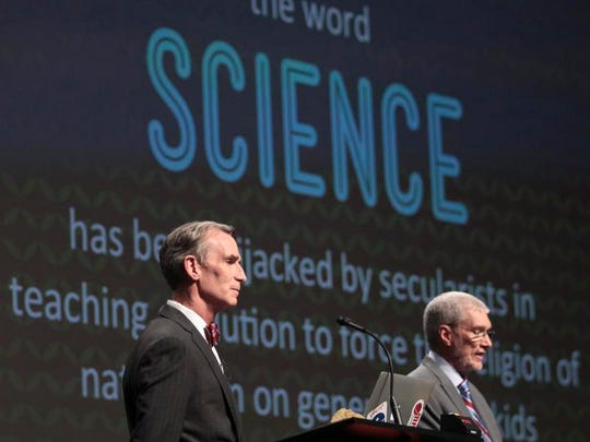 "Creation Museum head Ken Ham, right, speaks during a debate on evolution with TV's ""Science Guy"" Bill Nye at the Creation Museum on Tuesday in Petersburg, Ky. (The Courier-Journal, Matt Stone)"