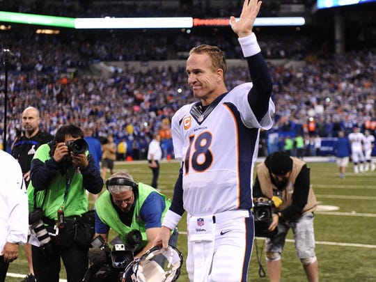 Oct 20, 2013; Indianapolis, IN, USA; Denver Broncos quarterback Peyton Manning waves to the crowd as he is honored on the field before the game against the Indianapolis Colts at Lucas Oil Stadium. Mandatory Credit: Ron Chenoy-USA TODAY Sports