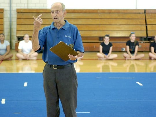 Hunter Talbott addresses the crowd during a showcase at the gymnastics camp at Shelburne Middle School in 2008.