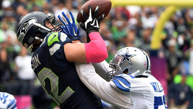 SEATTLE, WA - OCTBER 12: Outside linebacker Kyle Wilber #51 of the Dallas Cowboys breaks up a pass intended for tight end Luke Willson #82 of the Seattle Seahawks during the fourth quarter of the game at CenturyLink Field on October 12, 2014 in Seattle,Washington. (Photo by Steve Dykes/Getty Images)