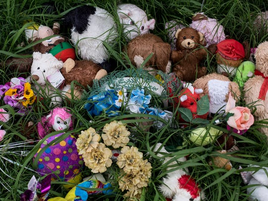 June 2, 2016 - Grass grows over a memorial for 15-year-old
