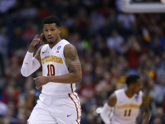 Iowa State's Darrell Bowie reacts after making a dunk