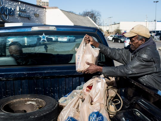 "January 05, 2018 - Charles Owens loads up his groceries after shopping at the Kroger at 2269 Lamar. ""ItÕs always pretty crowded but they say theyÕre shutting down,"" Owens said about the store. The Kroger on Lamar is one of two Kroger grocery stores in the core of Memphis that will close next month."