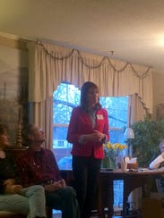 Cindy Axne speaks to voters at Margaret Vernon's home