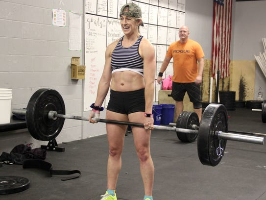 Orla Walsh, 31, of Fairfield, reacts as she dead lifts