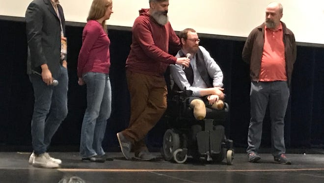 "Will Lautzenheiser answers questions from students following the screening of the documentary, ""Stumped,"" of how he lost his limbs and underwent arm transplants on Tuesday, Jan. 9, 2018, at the Performing Arts Center at Indio High School. With him are, from left, Zack Solomon, head of Education and Membership for the film festival; film director Robin Berghaus; Lautzenheiser's partner, Angel Gonzalez; and friend Charles Delfino."