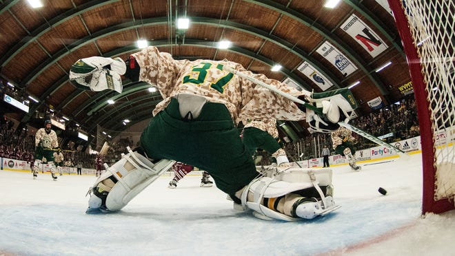 "Catamounts goalie Brody Hoffman (37) makes a save during a men's hockey game earlier this season. Hoffman was suspended indefinitely for ""violation of team values and expectations"" prior to Saturday's game."