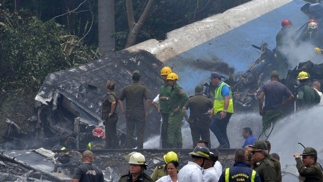 Emergency personnel work at the site of the accident after a Cubana de Aviacion aircraft crashed after taking off from Havana's Jose Marti airport on May 18, 2018.