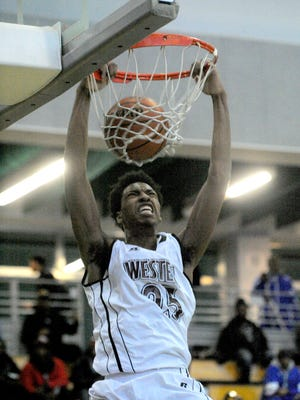Western's Greg Burris goes in for a dunk.