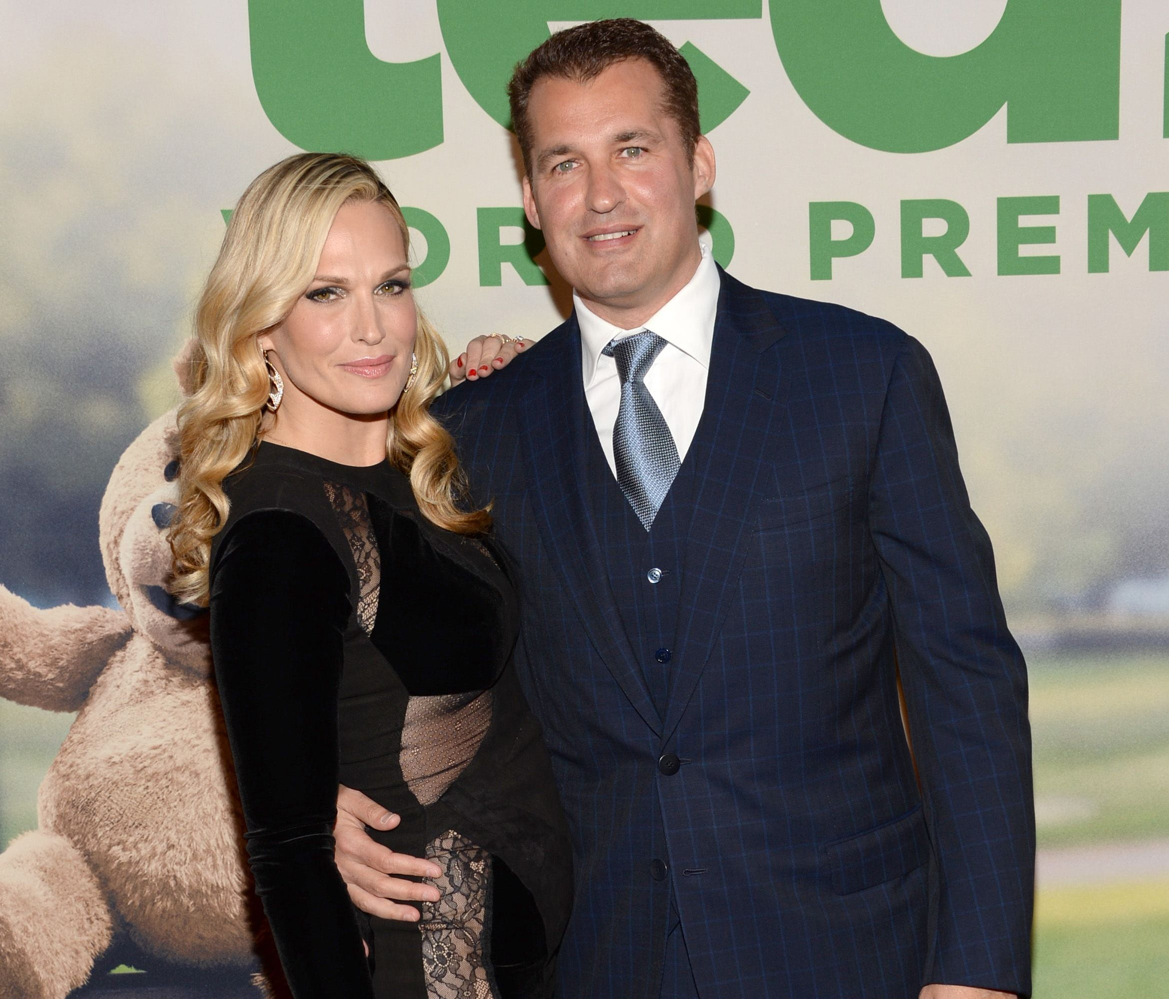 Molly Sims, left, and producer Scott Stuber attend the world premiere of