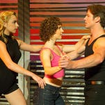 """Jenny Winton (Penny), left, Gillian Abbott (Baby) and Christopher Tierney (Johnny) are featured in the national tour of """"Dirty Dancing-The Classic Story on Stage,"""" continuing through Sunday at the Peace Center."""