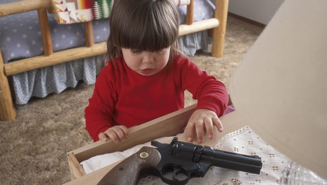 Young girl with hand gun
