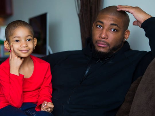 Bengals defensive tackle Devon Still sits with his daughter Leah at his home in Philadelphia.