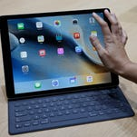 The new iPad Pro is seen with a Smart Keyboard during a product display following an Apple event.
