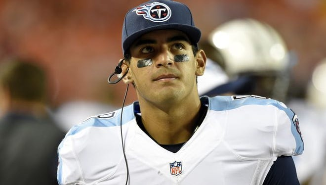 Marcus Mariota didn't complete a pass until the second quarter in the Titans' 34-10 loss to the Chiefs on Friday night.