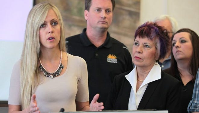 Everything Kitchens founder Emily Church, left, speaks at an event in 2015.
