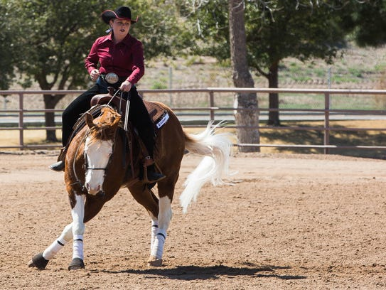 "Allison Nordvall and ""Gunny"" perform a spin during"