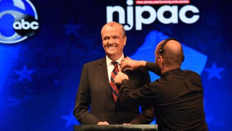 Phil Murphy, Democratic candidate for governor, is prepared with a microphone while onstage before the Oct. 10 debate at  NJPAC in Newark.