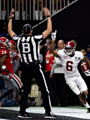 Alabama wide receiver DeVonta Smith (6) celebrates game winning touchdown during the NCAA National Championship football game between Alabama and Georgia on Monday, Jan. 8, 2018, in Atlanta, Ga.